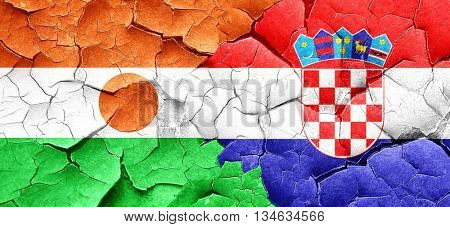 niger flag with Croatia flag on a grunge cracked wall