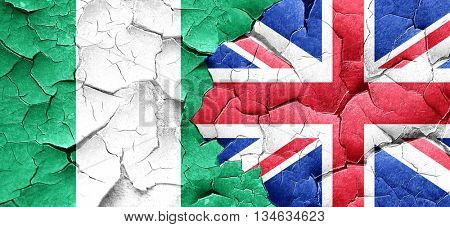Nigeria flag with Great Britain flag on a grunge cracked wall