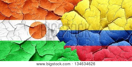 niger flag with Colombia flag on a grunge cracked wall