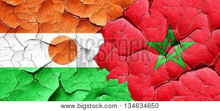 niger flag with Morocco flag on a grunge cracked wall