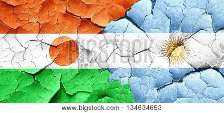 niger flag with Argentine flag on a grunge cracked wall