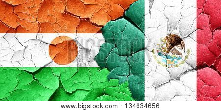 niger flag with Mexico flag on a grunge cracked wall