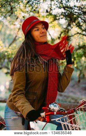Trendy Fashion Woman Riding Bike On Fall Season