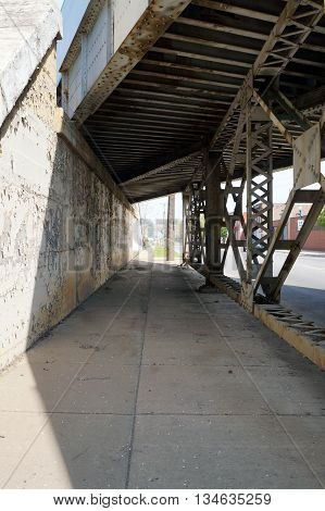 Pedestrians may walk through the Scott Street Viaduct near downtown Joliet, Illinois.