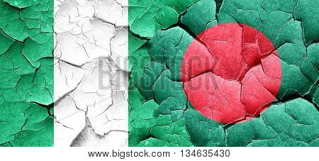 Nigeria flag with Bangladesh flag on a grunge cracked wall