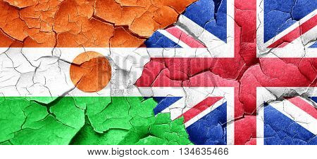 niger flag with Great Britain flag on a grunge cracked wall