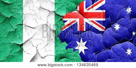 Nigeria flag with Australia flag on a grunge cracked wall