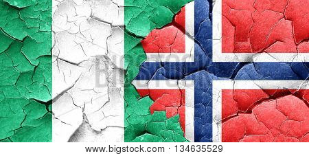 Nigeria flag with Norway flag on a grunge cracked wall