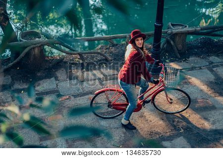 Fashionable Girl Riding Bike And Looking At Camera