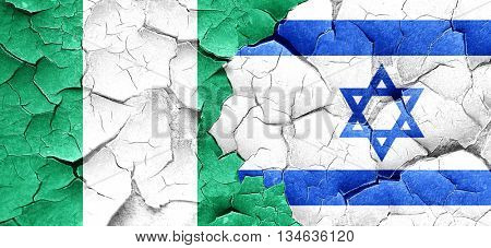 Nigeria flag with Israel flag on a grunge cracked wall