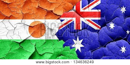 niger flag with Australia flag on a grunge cracked wall