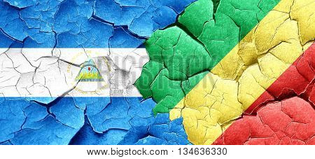 nicaragua flag with congo flag on a grunge cracked wall