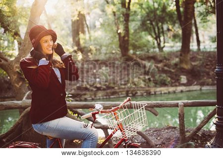 Retro Fashion Girl Riding Bike At Park On Fall Day