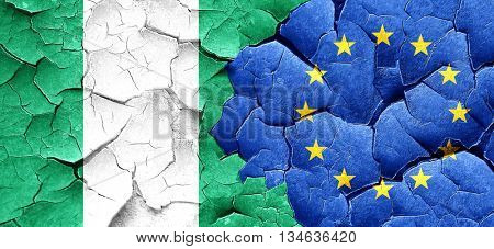 Nigeria flag with european union flag on a grunge cracked wall