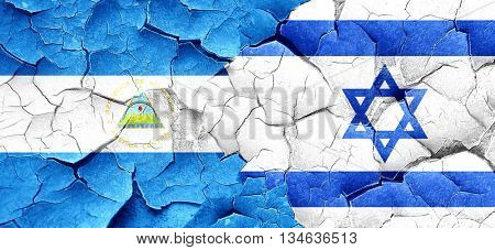 nicaragua flag with Israel flag on a grunge cracked wall
