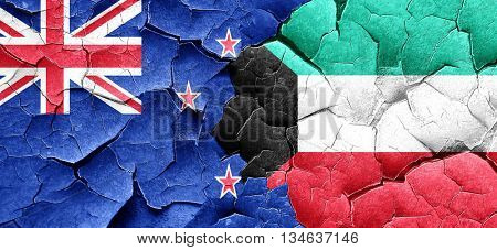 New zealand flag with Kuwait flag on a grunge cracked wall