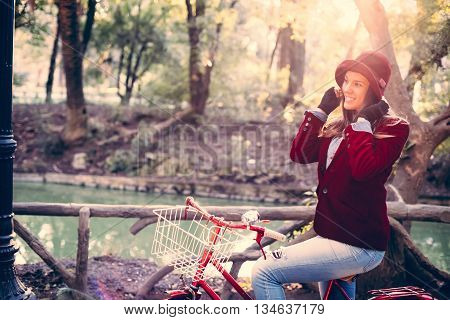 Happy Girl Riding Vintage Bike At Park On Fall Day