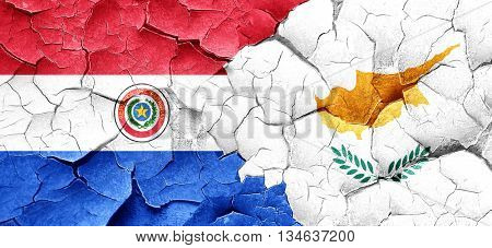 Paraguay flag with Cyprus flag on a grunge cracked wall