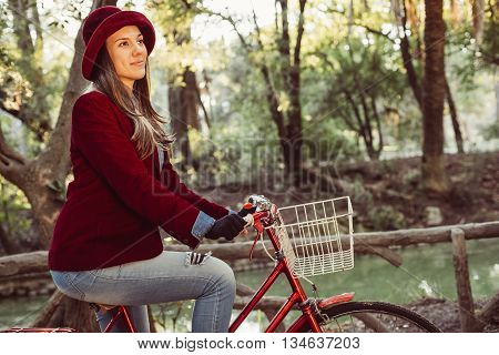 Woman In Vintage Fashion Riding Bike On Fall Day
