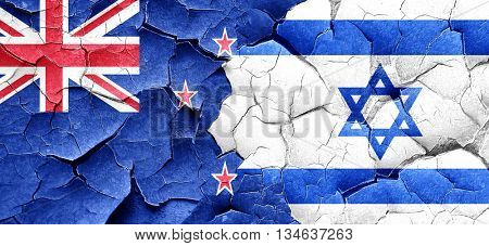 New zealand flag with Israel flag on a grunge cracked wall