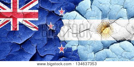 New zealand flag with Argentine flag on a grunge cracked wall