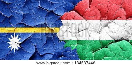 Nauru flag with Hungary flag on a grunge cracked wall