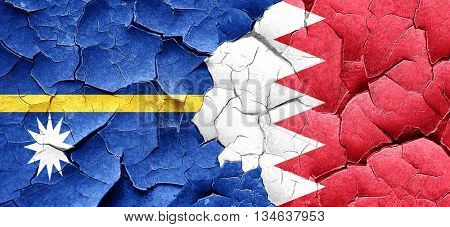 Nauru flag with Bahrain flag on a grunge cracked wall