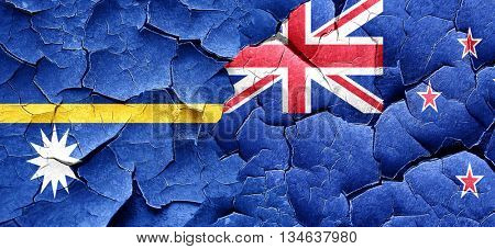 Nauru flag with New Zealand flag on a grunge cracked wall