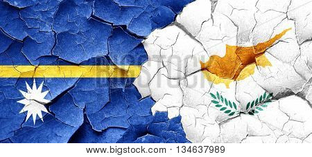 Nauru flag with Cyprus flag on a grunge cracked wall