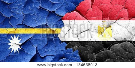 Nauru flag with egypt flag on a grunge cracked wall