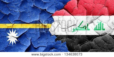 Nauru flag with Iraq flag on a grunge cracked wall