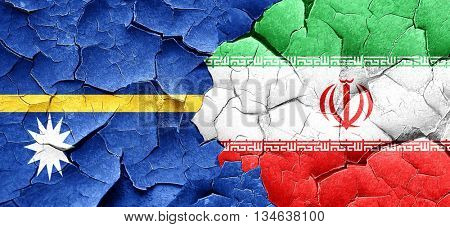 Nauru flag with Iran flag on a grunge cracked wall