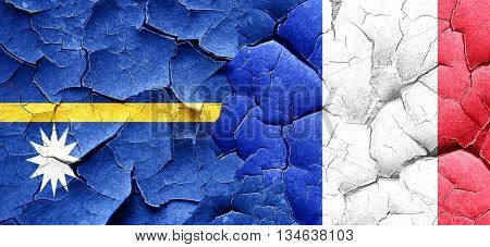 Nauru flag with France flag on a grunge cracked wall