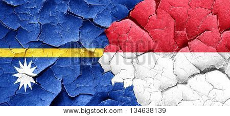 Nauru flag with Indonesia flag on a grunge cracked wall