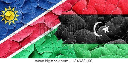 Namibia flag with Libya flag on a grunge cracked wall
