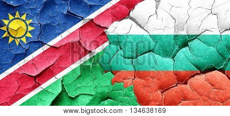 Namibia flag with Bulgaria flag on a grunge cracked wall