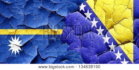 Nauru flag with Bosnia and Herzegovina flag on a grunge cracked