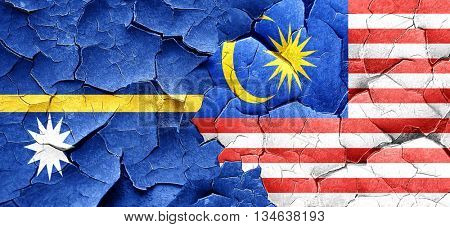 Nauru flag with Malaysia flag on a grunge cracked wall