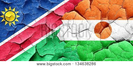 Namibia flag with Niger flag on a grunge cracked wall