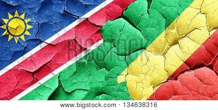 Namibia flag with congo flag on a grunge cracked wall