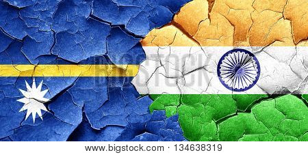 Nauru flag with India flag on a grunge cracked wall