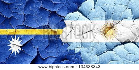 Nauru flag with Argentine flag on a grunge cracked wall