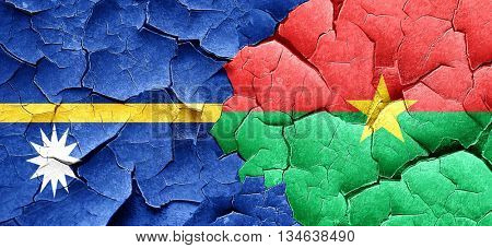 Nauru flag with Burkina Faso flag on a grunge cracked wall