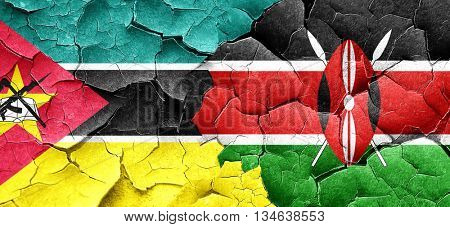 Mozambique flag with Kenya flag on a grunge cracked wall