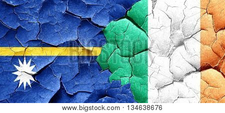 Nauru flag with Ireland flag on a grunge cracked wall