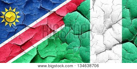 Namibia flag with Nigeria flag on a grunge cracked wall