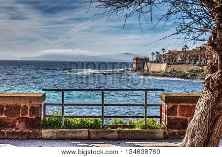 Alghero seafront under a cloudy sky Italy