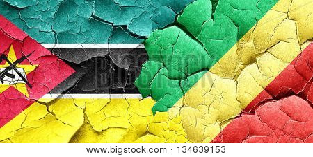 Mozambique flag with congo flag on a grunge cracked wall