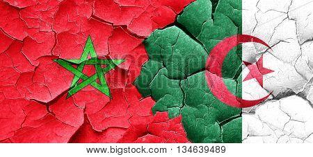 Morocco flag with Algeria flag on a grunge cracked wall