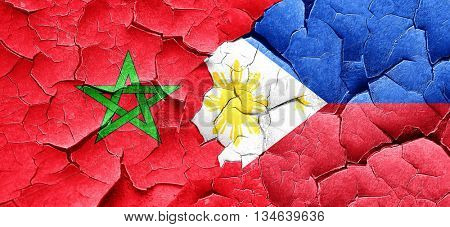 Morocco flag with Philippines flag on a grunge cracked wall